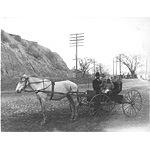 Father and 2 daughters with horse and buggy